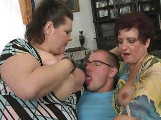 Three mature ladies fucking and sucking a toyboy
