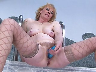Hairy mature slut getting wet by her toy