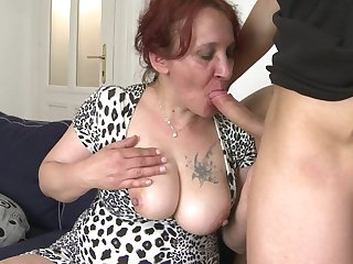 Naughty mature slut fucking her toy boy on the couch