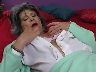 Horny mature slut masturbating on bed