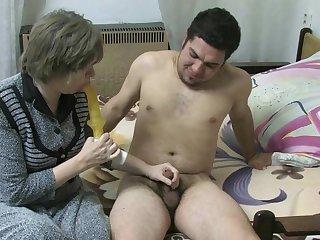Mature Dana is wanking his nice dick