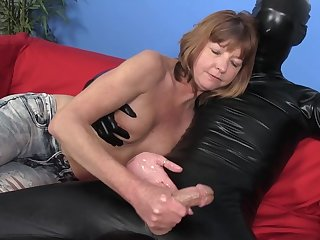 Slender mom is wanking a big dick