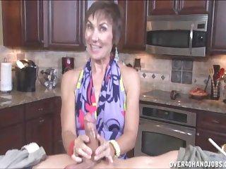 Sensual mature masturbates this cock in the kitchen