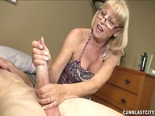 Mature mom gives a hot handjob