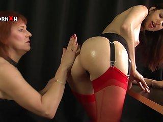 Faye Rampton puts her fist in Mishka Develin's pussy