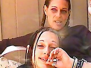 Women smoke and talk to the camera