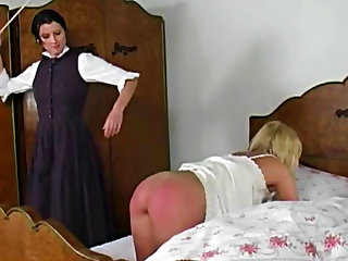 Naughty blonde gets her ass caned by conservative brunette