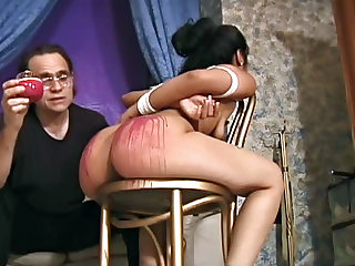 Hot wax dripped on a fantastic ass