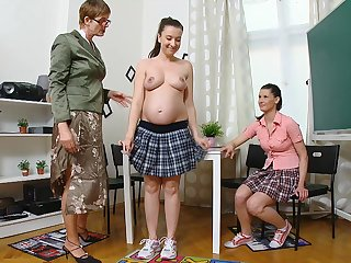 Simona and Martha are licking teacher's pussy