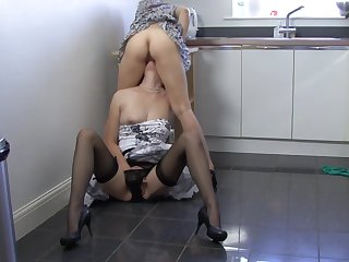 Masie and Lara Latex are fucking on the kitchen floor
