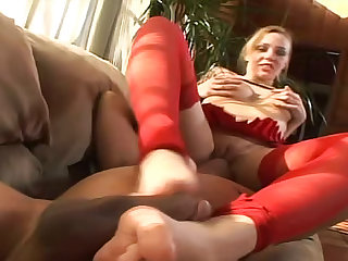 Sexy Annette Schwarz in red stockings is sucking huge wang