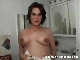 Preggo wife displays big tits