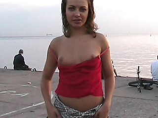 Yana are showing her body in the public place