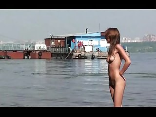 Nude girl prancing in the river