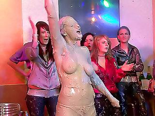 Milky goo poured on hot women