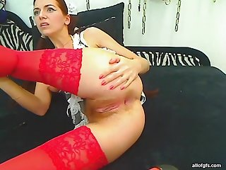 Redhead girlfriend plays with rubber dick
