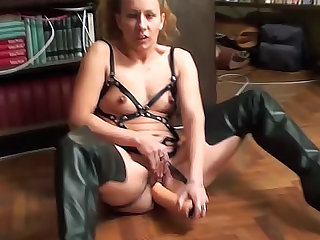 Leather lingerie and boots on dildo girl