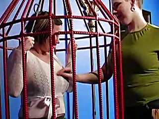 Big breasted teen slut gets trapped in a cage
