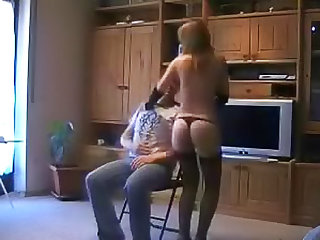 He sits and GF worships his cock
