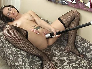Tattooed milf Skye is stroking her snatch