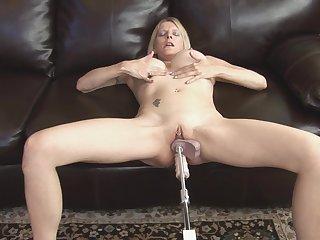 Milf Nikki West fucks with two dildos