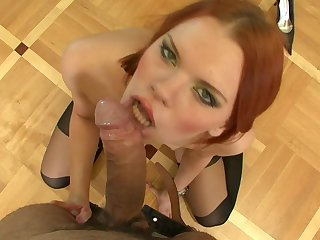 Redhead milf is sucking this tasty dong