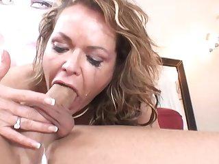 MILF Kelly Leigh gives a nasty deepthroat blowjob