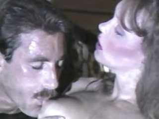 Retro sex with a busty brunette in doggy style
