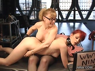Blonde milf is fisting her submissive