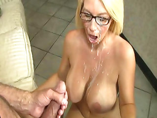 Facial time for MILF blonde with big tits and glasses