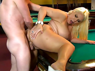Pretty chubby blonde is fucking on the table