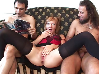 Horny as hell babe Clara is sucking two dicks