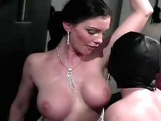 Hottie in red latex is spanking ass of her slave