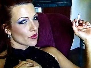 Sexy smoking milf demonstrating herself