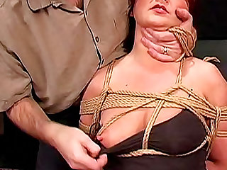 He ties her up and she submits