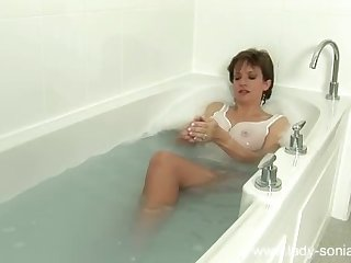 Sexy big tits milf bathes