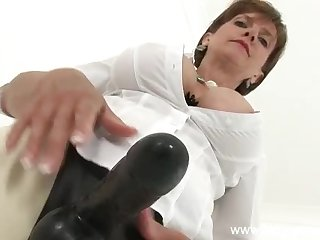Milf wears a big black strapon