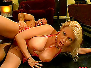 Super busty blonde whore sucking a big cock and getting a facial