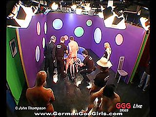 German slut being gangbanged by a large number of men