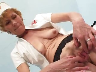 Older madam self exam on gynochair plus spekula