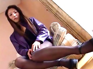 She is a hot milf Asian lady in black pantyhose