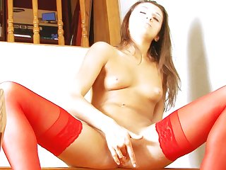 Incredible Russian solo girl Nadyenka is showing her masturbation action, while wearing hot stockings.