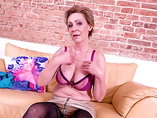 Older mature granny lady going wild while playing with her well preserved body