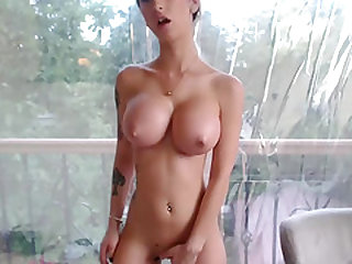Gorgeus Tattooed Plays With Her Hot Body