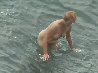 Worth to see the erotic horny wife that is walking naked on the nudist beach