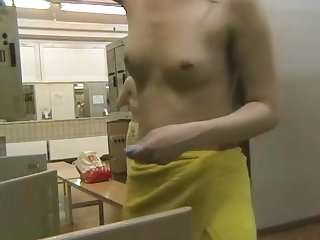 sweet chick with natural boobies is walking in the locker room and playing with hard nipples