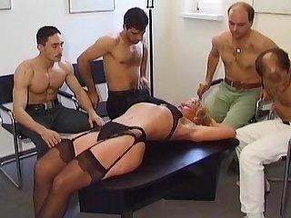 Awesome gangbang scene with gorgeous babe, fucked in doggy style on a table.
