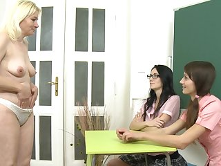 Nice looking threesome teen with small tits spreads her legs like a schoolgirl and fingers her shaved pussy