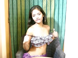 Long haired Indian teen beauty astonishes us with her miniature, perfectly shaved pussy in the solo action.