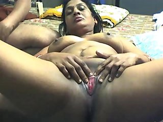 Fatty Indian girlfriend got a plastic bottle in her shaved pussy by her boyfriend in the amateur action.